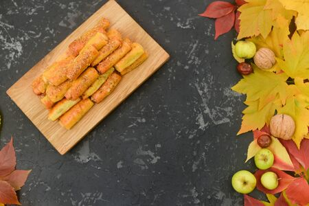 Delicious homemade cookies with apples and walnuts. Sweet pastries with an autumn theme and autumn yellow leaves. Autumn appetizing background Stok Fotoğraf