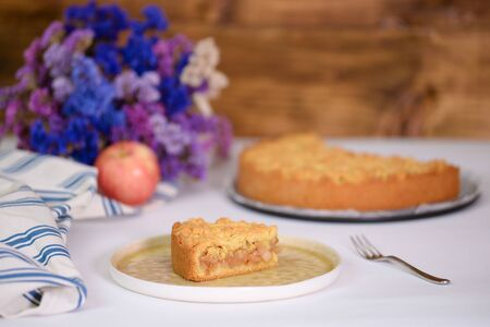 A piece of apple pie on white backstage Stok Fotoğraf