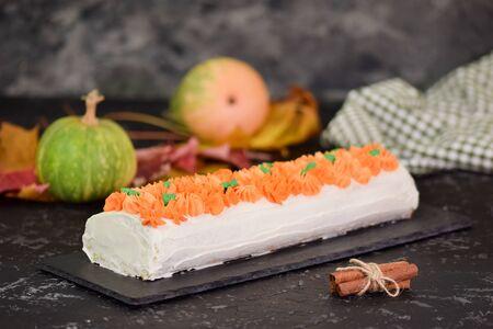 Fall dessert pumpkin roll with cream cheese. Bakery, frosting Reklamní fotografie