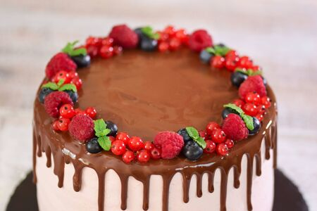 Delicious cake decorated with summer berries. Top view