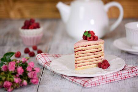 Slice of layered creamy fruit cake. Raspberry layer cake.