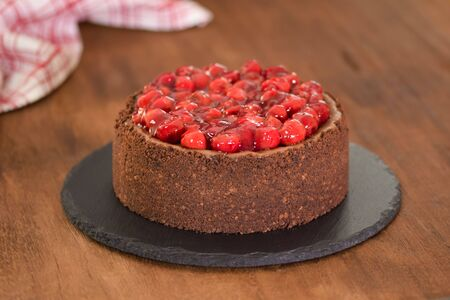 Delicious homemade chocolate cheesecake decorated with cherry sauce. Stok Fotoğraf