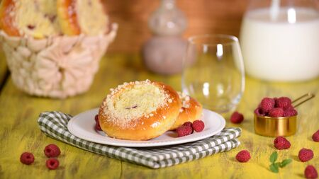 Fresh homemade open patties with cottage cheese. Traditional Russian pastry vatrushka, round buns with raspberries