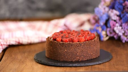 Delicious Homemade Chocolate Cheesecake Decorated With Cherry Sauce