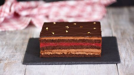 Modern chocolate mousse cake with a cherry layer. Delicious chocolate cherry cake