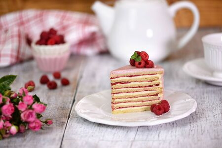 Slice Of Layered Creamy Fruit Cake. Raspberry Layer Cake