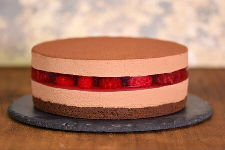 Delicious chocolate mousse cake with raspberries jelly.