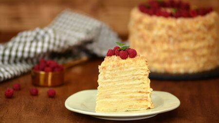 Slice Confectionery Napoleon Cake decorated with raspberry. Portion of Custard Cream Cake.