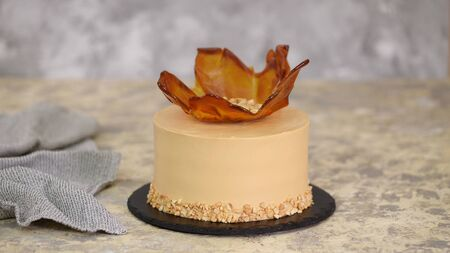 Tasty caramel cake with peanuts. Cake with caramel vase