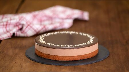 Delicious Chocolate Mousse Cake Decorate With Nuts On The Top