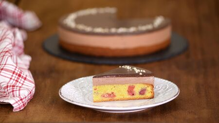 Piece of Chocolate Cherry Mousse Cake on a plate.