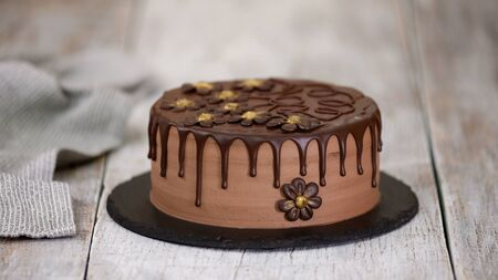 Delicious Chocolate Cake Decorated with Flowers. Prune Chocolate Cake