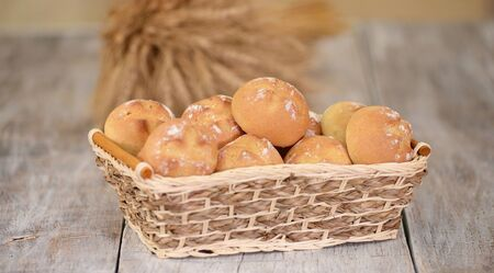 Fresh bread rolls in basket at traditional French bakery.