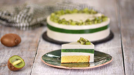Piece of homemade mousse cake with kiwi. French Cake With Fresh Kiwi.