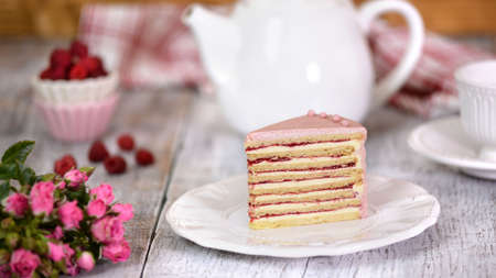 Slice Of Layered Creamy Fruit Cake. Raspberry Layer Cake.