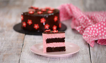 A piece of delicious strawberry mousse cake.