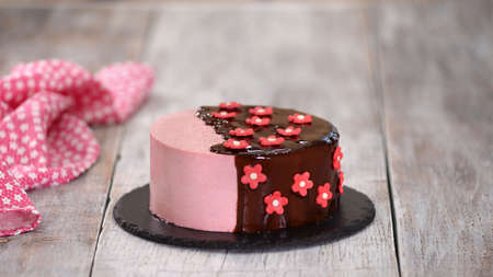 Strawberry Mousse Cake with Mirror Glaze and Sugar Flowers.