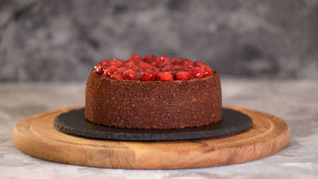 Delicious Homemade Chocolate Cheesecake Decorated With Cherry Sauce. Stockfoto