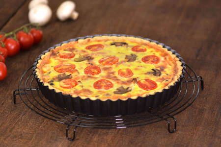 Homemade quiche lorraine with chicken, mushrooms and cheese. French cuisine.