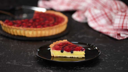 Piece of berry tart with pudding and jelly.