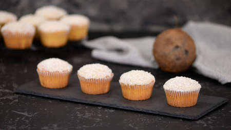 Tasty homemade muffins with coconut powder. Healthy breakfast.