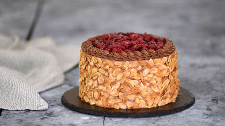 Delicious homemade chocolate cherry cake with almond flakes. Stockfoto