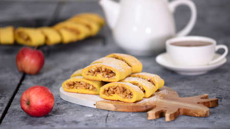 Delicious homemade apple cookies on wood board with a cup of tea. Stockfoto