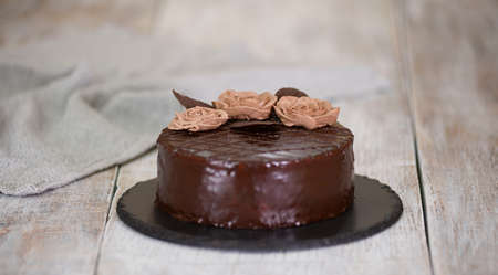 Chocolate cake with chocolate glaze and cream, Prague. 스톡 콘텐츠