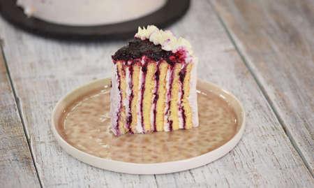 Piece of Homemade Vertical Layer Blackcurrant Jam Cake.