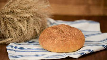 Freshly baked bread on a kitchen towel.
