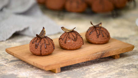 Choux au Craquelin with chocolate. Delicious French dessert. 스톡 콘텐츠