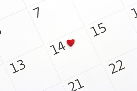 Calendar page with the red hearts from tapes on February 14 of Saint Valentines day