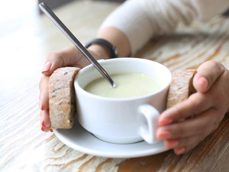brocolli: Bowl with cream brocolli soup and bread