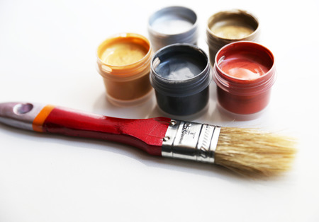 Set of colorful paints are located closed to red brush Stock Photo