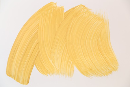 Golden shining texture on blank white sheet. Made by brush. You can use it as texture for the signature
