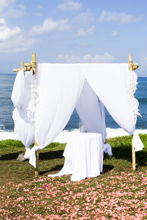 Romantic wedding ceremony on the hill closed to ocean.