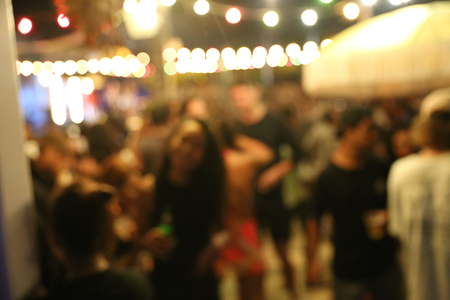 Blurred background of many people had fun at a beach party