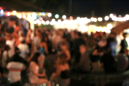 Blurred background of many people had fun at a beach party. 写真素材