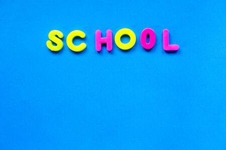 Brigh blue backgroun with the inscription school on trendy neon background. 写真素材