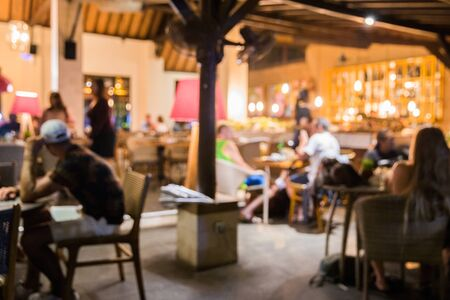 Blurred background of people in the cafe. Big long table in loft style. social distance concept