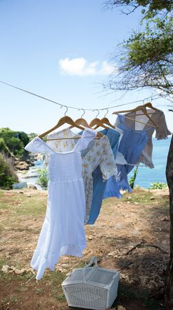 Clothes hanging on a washing line to dry in nature. Trendy presentation of cloths in fashion.