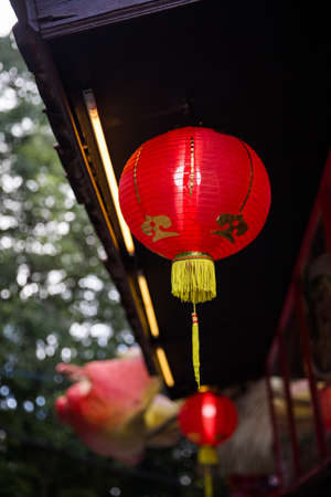 Chinese new year decoration. Red lantern on a festive background.