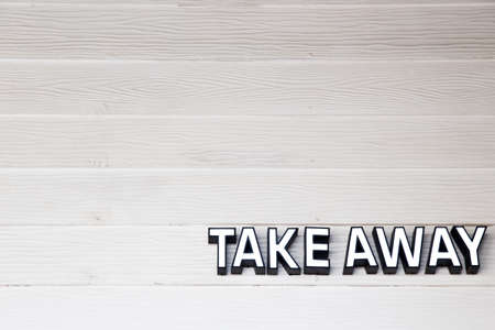 Take awas signature on wooden textured wall. Pandemic concept.