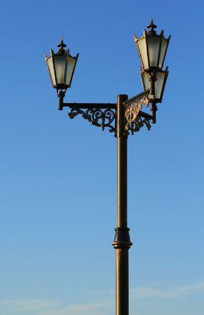 Old Street lamp on blue sky photo