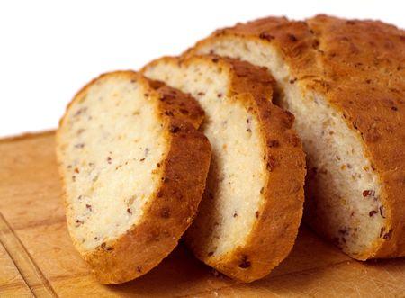 Fresh cut bread on cutting board