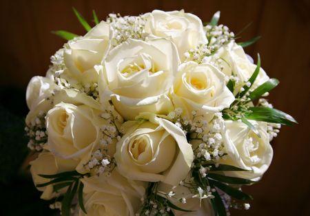 beige wedding bouquet on a dark background