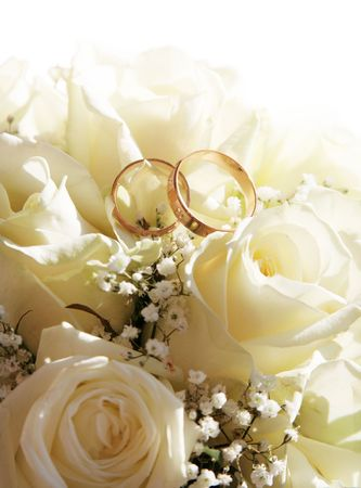 Wedding rings and roses can use as background photo