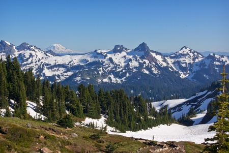 capped: snow covered mountainsin the pacific northwest part of the united states. Stock Photo