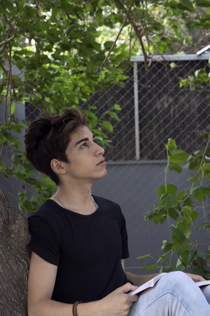 good looking teenage guy: guy teen student outdoors in the summer Stock Photo