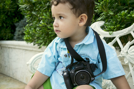 2 years: boy 2 years with a camera outdoors Stock Photo
